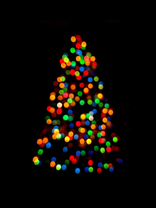 Photo of lights on a Christmas tree by Rae Galatas via Unsplash