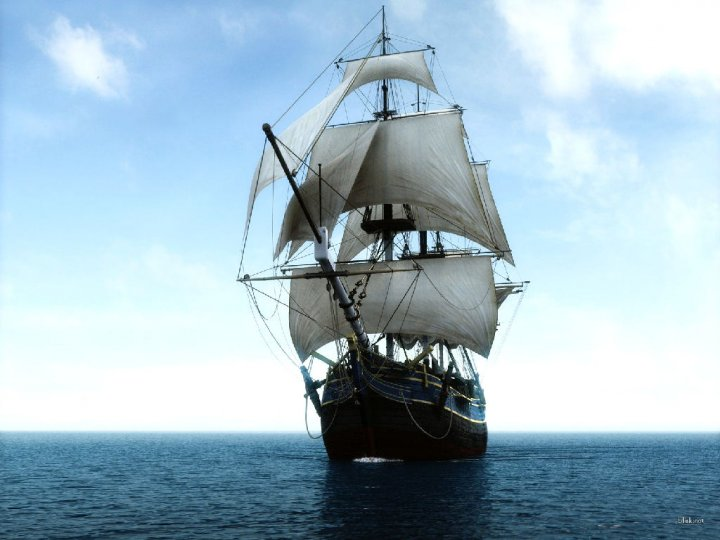 photo of a sailing ship in full sail