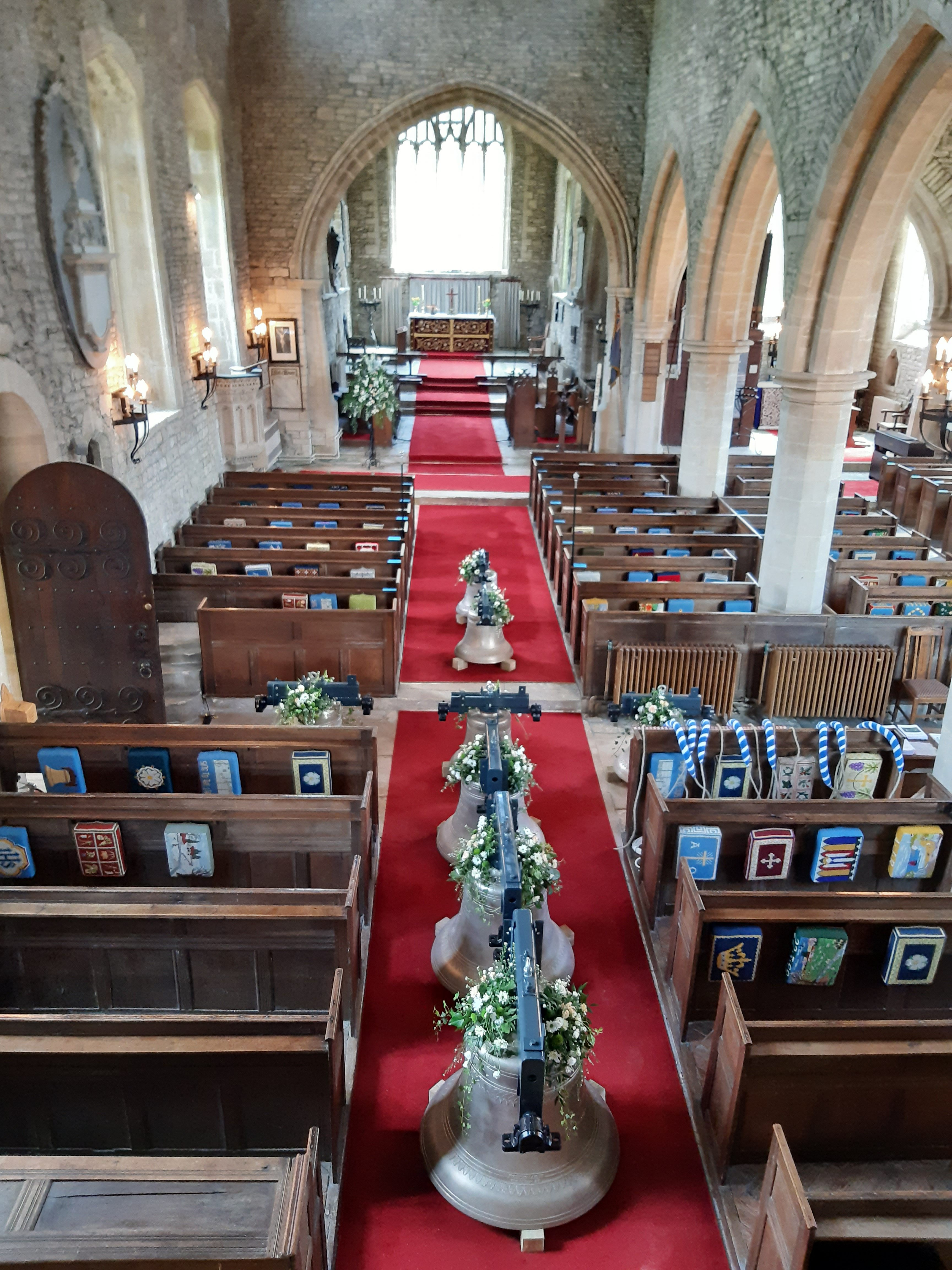aerial view of bells in church aisle
